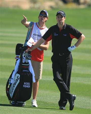 MARANA, AZ - FEBRUARY 27:  Ross Fisher of England and caddie discuss his approach shot on the first hole during the third round of the Accenture Match Play Championship at the Ritz-Carlton Golf Club at Dove Mountain on February 27, 2009 in Marana, Arizona.  (Photo by Scott Halleran/Getty Images)