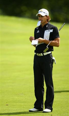 LUSS, SCOTLAND - JULY 08:  Camilo Villegas of Colombia makes some notes during the Pro Am prior to The Barclays Scottish Open at Loch Lomond Golf Club on July 08, 2009 in Luss, Scotland.  (Photo by Richard Heathcote/Getty Images)