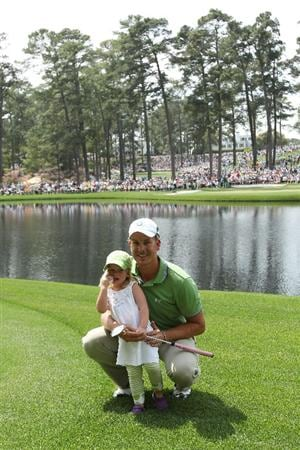 AUGUSTA, GA - APRIL 07:  Henrik Stenson of Sweden waits with his daughter Lisa during the Par 3 Contest prior to the 2010 Masters Tournament at Augusta National Golf Club on April 7, 2010 in Augusta, Georgia.  (Photo by Andrew Redington/Getty Images)