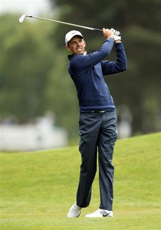 VIRGINIA WATER, ENGLAND - MAY 27:  Charl Schwartzel of South Africa hits an approach shot during the second round of the BMW PGA Championship at the Wentworth Club on May 27, 2011 in Virginia Water, England.  (Photo by Ian Walton/Getty Images)