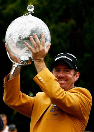 MELBOURNE, AUSTRALIA - NOVEMBER 30:  Rod Pampling of Australia raises the trophy after winning the 2008 Australian Masters at Huntingdale Golf Club on November 30, 2008 in Melbourne, Australia  (Photo by Quinn Rooney/Getty Images)