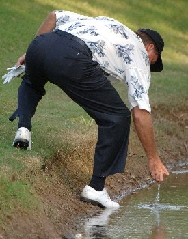 Keith Fergus pulls a ball from the water on the 18th hole  during the second round of  the 2005 Bruno's Memorial Classic, May 21, in Hoover, Al.Photo by Al Messerschmidt/WireImage.com