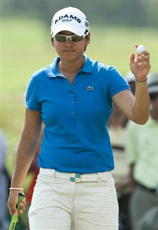CHON BURI, THAILAND - FEBRUARY 19:  Yani Tseng of Taiwan acknowledges the crowd on the 14th green during day three of the LPGA Thailand at Siam Country Club on February 19, 2011 in Chon Buri, Thailand.  (Photo by Victor Fraile/Getty Images)