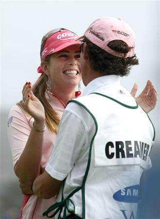 HALF MOON BAY, CA - OCTOBER 05:  Paula Creamer hugs her caddie Colin Cann on the 18th hole after winning during the final round of the Samsung World Championship at the Half Moon Bay Golf Links Ocean Course on October 5, 2008 in Half Moon Bay, California.  (Photo by Jonathan Ferrey/Getty Images)