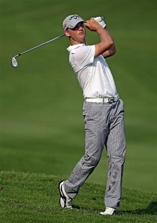 KUALA LUMPUR, MALAYSIA - MARCH 04:  Niclas Fasth of Sweden hits his second shot on the 16th hole during the first round of the Maybank Malaysian Open at the Kuala Lumpur Golf and Country Club on March 4, 2010 in Kuala Lumpur, Malaysia.  (Photo by Andrew Redington/Getty Images)