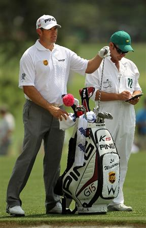 AUGUSTA, GA - APRIL 09:  Lee Westwood of England waits with his caddie Billy Foster on the first hole during the third round of the 2011 Masters Tournament at Augusta National Golf Club on April 9, 2011 in Augusta, Georgia.  (Photo by Jamie Squire/Getty Images)