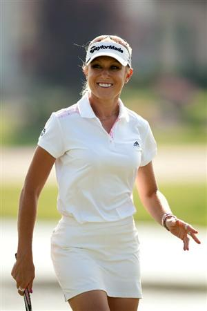 SPRINGFIELD, IL - JUNE 11: Natalie Gulbis smiles after making a birdie putt during the second round of the LPGA State Farm Classic at Panther Creek Country Club on June 11, 2010 in Springfield, Illinois. (Photo by Darren Carroll/Getty Images)