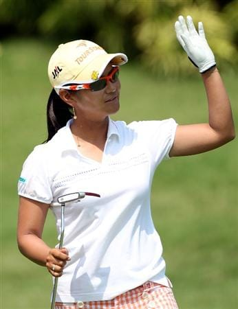 SINGAPORE - FEBRUARY 28:  Ai Miyazato of Japan celebrates on the 18th green after winning the HSBC Women's Champions at the Tanah Merah Country Club on February 28, 2010 in Singapore.  (Photo by Andrew Redington/Getty Images)