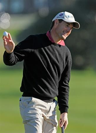 PEBBLE BEACH, CA - FEBRUARY 11:  Padraig Harrington of Ireland waves his ball on the third hole during the second round of the AT&T Pebble Beach National Pro-Am at the Pebble Beach Golf Links on February 11, 2011  in Pebble Beach, California  (Photo by Stuart Franklin/Getty Images)
