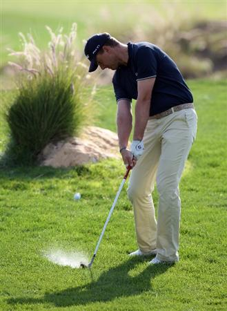 DOHA, QATAR - JANUARY 21:  Robert Karlsson of Sweden plays his second shot on the par four 4th hole  during the pro-am event prior to the Commercialbank Qatar Masters at the Doha Golf Club on January 20,2009 in Doha, Qatar.  (Photo by Ross Kinnaird/Getty Images)