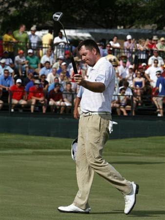 MEMPHIS, TN - JUNE 13: Robert Garrigus of the United States waves to the crowd after his final putt on the 18th green in the playoffs with Robert Karlsson and Lee Westwood in final round of the St. Jude Classic at TPC Southwind held on June 13, 2010 in Memphis, Tennessee.  (Photo by John Sommers II/Getty Images)