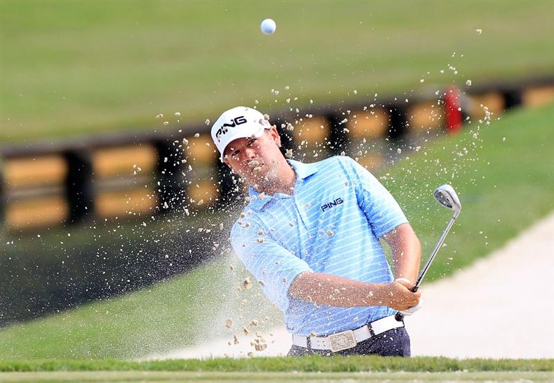 PONTE VEDRA BEACH, FL - MAY 11:  Alex Prugh hits from a bunker during a practice round prior to the start of THE PLAYERS Championship held at THE PLAYERS Stadium course at TPC Sawgrass on May 11, 2011 in Ponte Vedra Beach, Florida.  (Photo by Sam Greenwood/Getty Images)