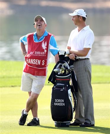 ABU DHABI, UNITED ARAB EMIRATES - JANUARY 22: Soren Hansen of Denmark and his caddie Phil Morby during the second round of the Abu Dhabi Golf Championship at the Abu Dhabi Golf Club on January 22, 2010 in Abu Dhabi, United Arab Emirates.  (Photo by Ross Kinnaird/Getty Images)