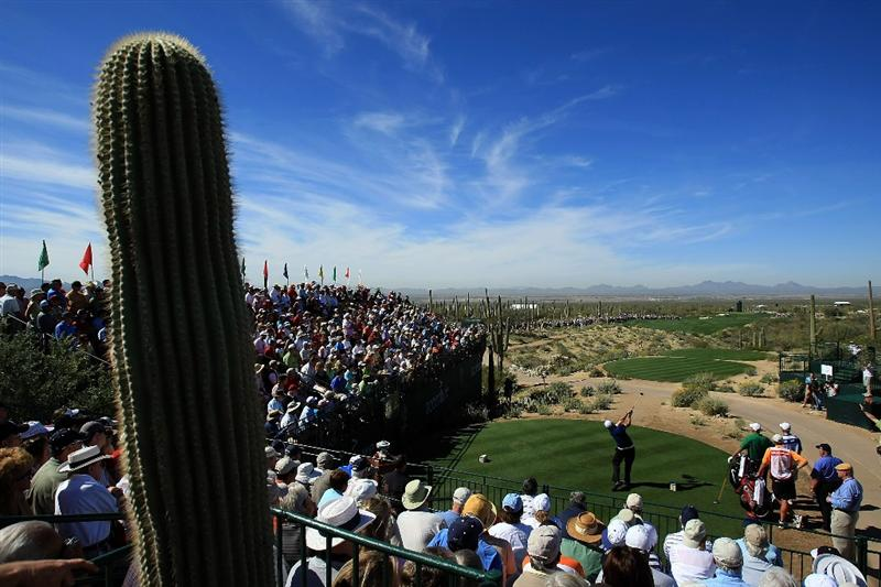 MARANA, AZ - FEBRUARY 27:  Phil Mickelson hits his tee shot on the first hole during the third round of the Accenture Match Play Championship at the Ritz-Carlton Golf Club at Dove Mountain on February 27, 2009 in Marana, Arizona.  (Photo by Scott Halleran/Getty Images)
