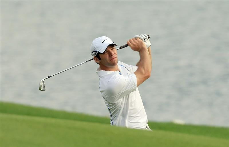 BAHRAIN, BAHRAIN - JANUARY 28:  Paul Casey of England plays his second shot at the 15th hole during the second round of the 2011 Volvo Champions held at the Royal Golf Club on January 28, 2011 in Bahrain, Bahrain.  (Photo by David Cannon/Getty Images)