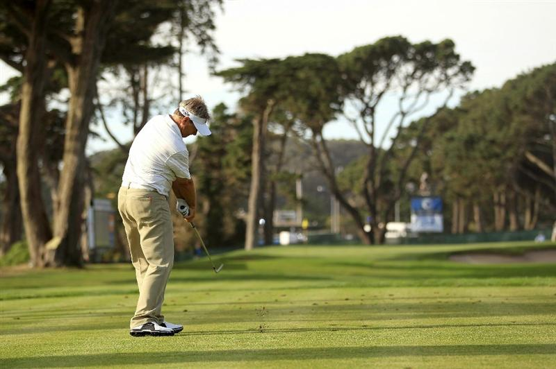 SAN FRANCISCO - NOVEMBER 04:  John Cook tees off on the 17th hole during round 1 of the Charles Schwab Cup Championship at Harding Park Golf Course on November 4, 2010 in San Francisco, California.  (Photo by Ezra Shaw/Getty Images)