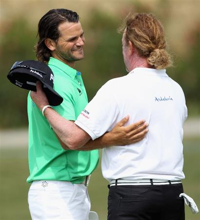 CASARES, SPAIN - MAY 20:  Johan Edfors of Sweden (left) shakes hands with Miguel Angel Jimenez of Spain after winning his match during the group stages of the Volvo World Match Play Championship at Finca Cortesin on May 20, 2011 in Casares, Spain.  (Photo by Andrew Redington/Getty Images)