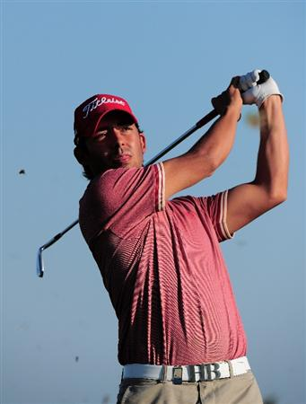 VILAMOURA, PORTUGAL - OCTOBER 14:  Pablo Larrazabal of Spain plays an approach shot during the pro - am prior to the start of the Portugal Masters at the Oceanico Victoria Golf Course on October 14, 2009 in Vilamoura, Portugal.  (Photo by Stuart Franklin/Getty Images)