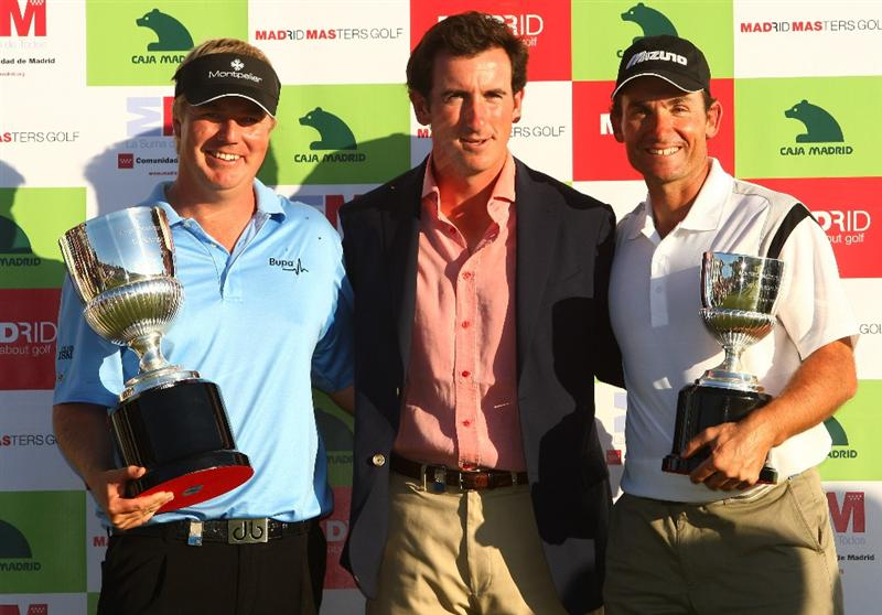 MADRID, SPAIN - OCTOBER 11:  Ross McGowan (L) of England celebrates with the trophy after winning the Final Round of the Madrid Masters at Cantro Nacional De Golf on October 9, 2009 in Madrid, Spain.  (Photo by Ian Walton/Getty Images)