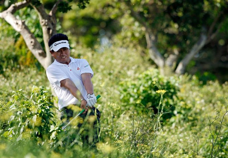 SOUTHAMPTON, BERMUDA - OCTOBER 20:  Y.E. Yang of South Korea, the 2009 PGA Championship winner, hits his second shot on the 17th hole during the first round of the PGA Grand Slam of Golf on October 20, 2009 Port Royal Golf Course in Southampton, Bermuda.  (Photo by Andy Lyons/Getty Images)