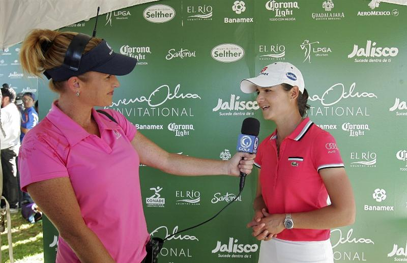 GUADALAJARA, MEXICO - NOVEMBER 13:  Lorena Ochoa (R) of Mexico is interviewed by Stephanie Sparks of The Golf Channel during the third round of the Lorena Ochoa Invitational Presented by Banamex and Corona Light at Guadalajara Country Club on November 13, 2010 in Guadalajara, Mexico.  (Photo by Michael Cohen/Getty Images)