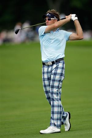 CHASKA, MN - AUGUST 13:  Ian Poulter of England watches his approach shot on the seventh hole during the first round of the 91st PGA Championship at Hazeltine National Golf Club on August 13, 2009 in Chaska, Minnesota.  (Photo by Jamie Squire/Getty Images)