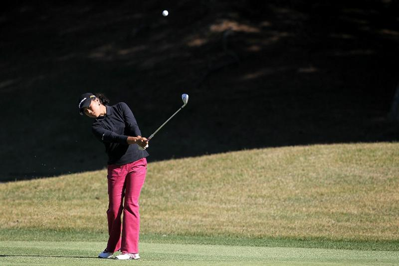 SHIMA, JAPAN - NOVEMBER 05:  Lee Seon-hwa of South Korea plays an approach shot on the 13th hole during round one of the Mizuno Classic at Kintetsu Kashikojima Country Club on November 5, 2010 in Shima, Mie, Japan.  (Photo by Kiyoshi Ota/Getty Images)