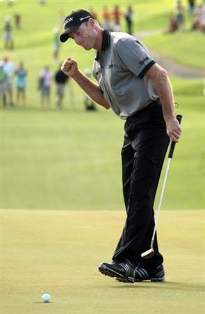 TUCKER'S TOWN, BERMUDA - OCTOBER 15: Jim Furyk of the USA holes the winning putt at the first play-off hole during the final round of the PGA Grand Slam of Golf at the Mid Ocean Club on October 15, 2008 in Tucker's Town, Bermuda. (Photo by Ross Kinnaird/Getty Images)