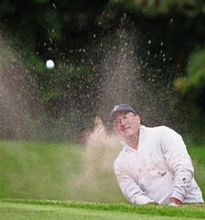 DUMBARTON, SCOTLAND - SEPTEMBER 18:  James Lee of Great Britain plays out the bunker on the 12th green in the afternoon four ball matches at The Carrick on Loch Lomond on September 18, 2009 in Dumbarton, Scotland.  (Photo by Jeff J Mitchell/Getty Images)