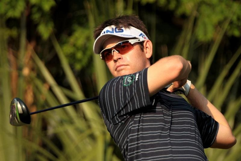 PONTE VEDRA BEACH, FL - MAY 10:  Louis Oosthuizen of South Africa hits a shot during a practice round prior to the start of THE PLAYERS Championship held at THE PLAYERS Stadium course at TPC Sawgrass on May 10, 2011 in Ponte Vedra Beach, Florida.  (Photo by Scott Halleran/Getty Images)