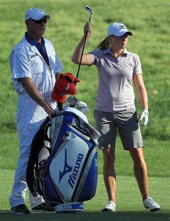 RANCHO MIRAGE, CA - APRIL 03:  Stacy Lewis of the USA waits to play her second shot with her caddie Travis Wilson on the par 4, 16th hole during the final round of the 2011 Kraft Nabisco Championship on the Dinah Shore Championship Course at the Mission Hills Country Club on April 3, 2011 in Rancho Mirage, California.  (Photo by David Cannon/Getty Images)