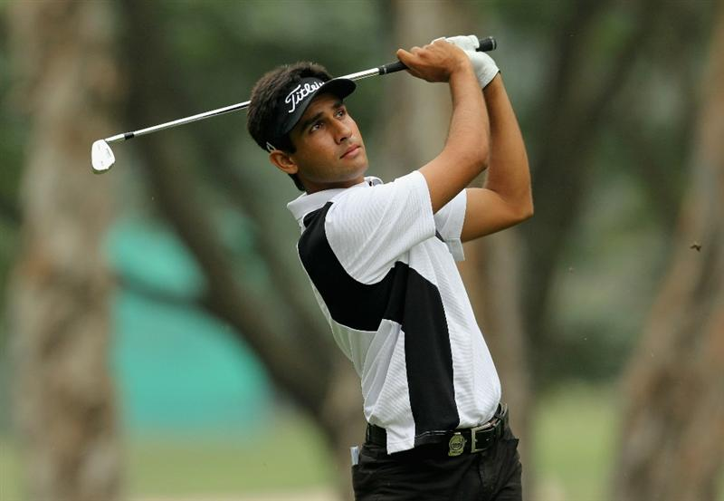 HONG KONG - NOVEMBER 18: Himmat Rai of India watches his 2nd shot on the 7th hole during the first round of the USB Hong Kong Open at The Hong Kong Golf Club  on November 18, 2010 in Hong Kong, Hong Kong.  (Photo by Stanley Chou/Getty Images)