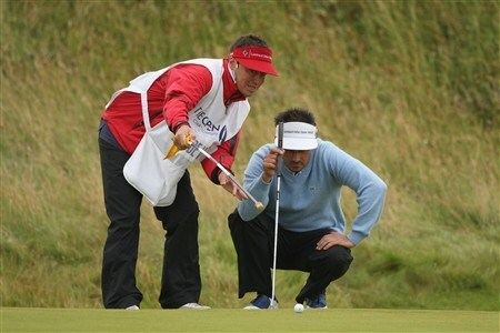 SOUTHPORT, UNITED KINGDOM - JULY 18:  Jean van de Velde of France lines up a putt on the 14th green with caddie Ivan Galdame during the second round of the 137th Open Championship on July 18, 2008 at Royal Birkdale Golf Club, Southport, England.  (Photo by Warren Little/Getty Images)