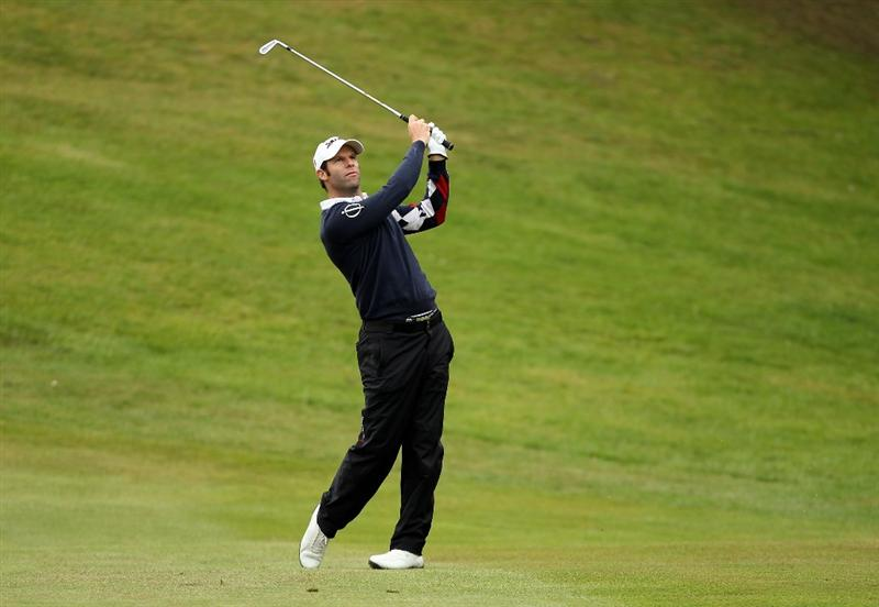 VIRGINIA WATER, ENGLAND - MAY 27:  Bradley Dredge of Wales hits an approach shot during the second round of the BMW PGA Championship at the Wentworth Club on May 27, 2011 in Virginia Water, England.  (Photo by Ian Walton/Getty Images)