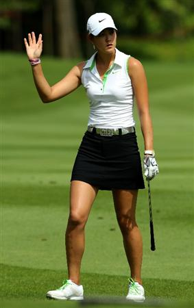 KUALA LUMPUR, MALAYSIA - OCTOBER 22:  Michelle Wie of USA waves to the crowd after playing her shot on the 1st hole during Round One of the Sime Darby LPGA on October 22, 2010 at the Kuala Lumpur Golf and Country Club in Kuala Lumpur, Malaysia. (Photo by Stanley Chou/Getty Images)