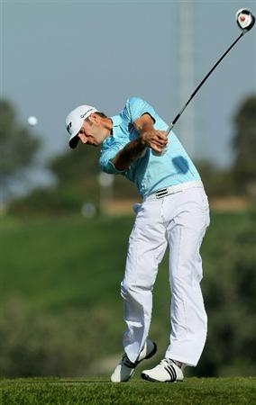 LA JOLLA, CA - JANUARY 29:  Dustin Johnson hits his tee shot on the fifth hole during round three of the Farmers Insurance Open at Torrey Pines South Course on January 29, 2011 in La Jolla, California.  (Photo by Stephen Dunn/Getty Images)