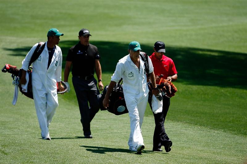 AUGUSTA, GA - APRIL 12:  Tiger Woods and his caddie Steve Williams walks off the third tee along with Phil Mickelson and his caddie Jim 'Bones' MacKay walk off the  during the final round of the 2009 Masters Tournament at Augusta National Golf Club on April 12, 2009 in Augusta, Georgia.  (Photo by Jamie Squire/Getty Images)