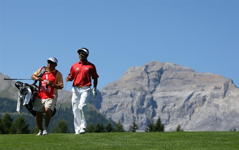 CRANS, SWITZERLAND - SEPTEMBER 06:  Thongchai Jaidee of Thailand walks with his caddie on the 12th hole during the final round of The Omega European Masters at Crans-Sur-Sierre Golf Club on September 6, 2009 in Crans Montana, Switzerland.  (Photo by Andrew Redington/Getty Images)