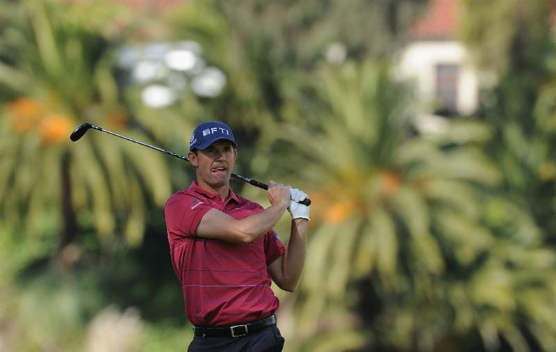 PACIFIC PALISADES, CA - FEBRUARY 19:  Padraig Harrington of Ireland plays his approach shot on the first hole during the third round of the Northern Trust Open at Riviera Country Club on February 19, 2011 in Pacific Palisades, California.  (Photo by Stuart Franklin/Getty Images)