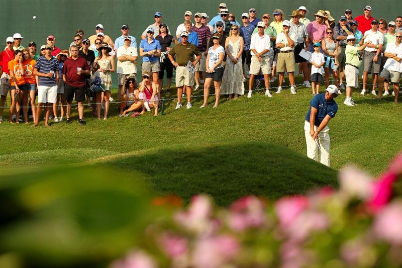 PONTE VEDRA BEACH, FL - MAY 14:  Phil Mickelson plays a shot on the ninth hole during the third round of THE PLAYERS Championship held at THE PLAYERS Stadium course at TPC Sawgrass on May 14, 2011 in Ponte Vedra Beach, Florida.  (Photo by Mike Ehrmann/Getty Images)