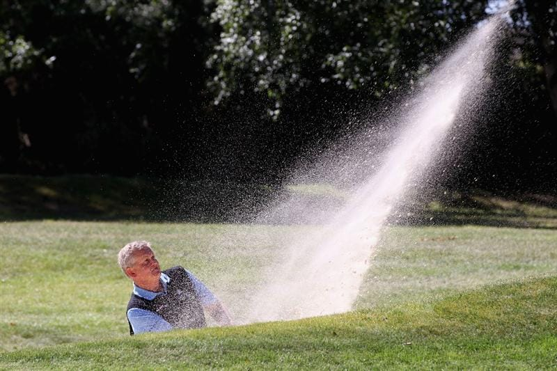 VIRGINIA WATER, ENGLAND - MAY 25: Colin Montgomerie of Scotland plays a shot from the bunker during the Pro-Am round prior to the BMW PGA Championship at Wentworth Club on May 25, 2011 in Virginia Water, England.  (Photo by Ross Kinnaird/Getty Images)