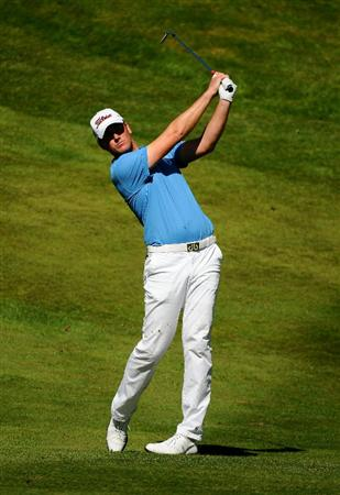 VIRGINIA WATER, ENGLAND - MAY 23:  Robert Karlsson of Sweden hits an approach shot on the 4th hole during the final round of the BMW PGA Championship on the West Course at Wentworth on May 23, 2010 in Virginia Water, England.  (Photo by Richard Heathcote/Getty Images)