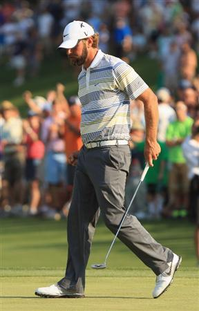 CHARLOTTE, NC - MAY 08:  Lucas Glover celebrates his par saving putt on the 18th green during the final round of the Wells Fargo Championship at the Quail Hollow Club on May 8, 2011 in Charlotte, North Carolina.  (Photo by Streeter Lecka/Getty Images)