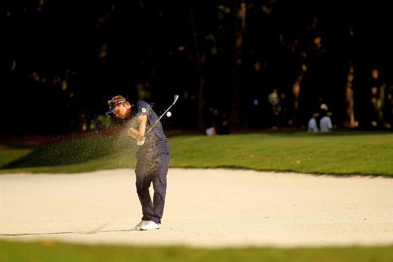 PONTE VEDRA BEACH, FL - MAY 15:  Luke Donald of England hits from a bunker on the 15th hole during the final round of THE PLAYERS Championship held at THE PLAYERS Stadium course at TPC Sawgrass on May 15, 2011 in Ponte Vedra Beach, Florida.  (Photo by Mike Ehrmann/Getty Images)