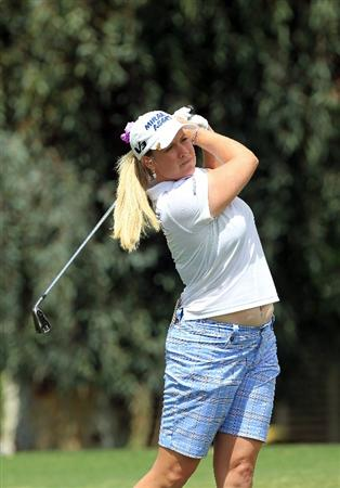 RANCHO MIRAGE, CA - APRIL 02:  Brittany Lincicome of the USA plays her second shot at the par 5, 2nd hole during the third round of the 2011 Kraft Nabisco Championship on the Dinah Shore Championship Course at the Mission Hills Country Club on April 2, 2011 in Rancho Mirage, California.  (Photo by David Cannon/Getty Images)