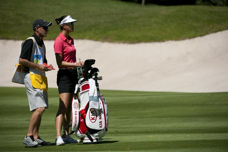 ROGERS, AR - SEPTEMBER 12:  Michelle Wie (R) stands next to her golf bag and her caddie on the seventh fairway during the final round of the P&G NW Arkansas Championship at the Pinnacle Country Club on September 12, 2010 in Rogers, Arkansas.  (Photo by Robert Laberge/Getty Images)
