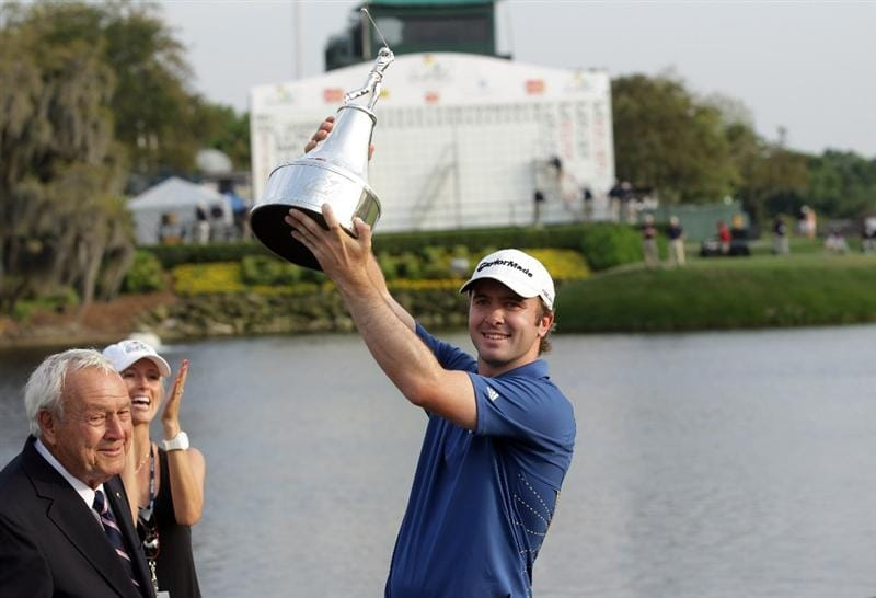 ORLANDO, FL - MARCH 27:  Martin Laird of Scotland is presented with the trophy by Arnold Palmer after the final round of the 2011 Arnold Palmer Invitational presented by Mastercard at the Bay Hill Lodge and Country Club on March 27, 2011 in Orlando, Florida.  (Photo by David Cannon/Getty Images)