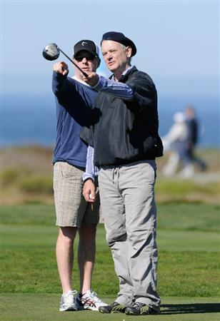 PEBBLE BEACH, CA - FEBRUARY 10:  Actor Bill Murray discusses a shot with his caddie during the first round of the AT&T Pebble Beach National Pro-Am at Monterey Peninsula Country Club on February 10, 2011  in Pebble Beach, California.  (Photo by Stuart Franklin/Getty Images)