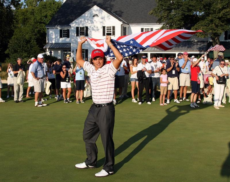 ARDMORE, PA - SEPTEMBER 13: Rickie Fowler of the USA celebrates on the 18th green after the USA team had secured victory during the final afternoon singles matches on the East Course at Merion Golf Club on September 13, 2009 in Ardmore, Pennsylvania  (Photo by David Cannon/Getty Images)