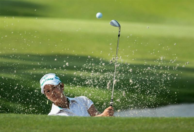 SINGAPORE - FEBRUARY 25:  Ai Miyazato of Japan plays a bunker shot on the 14th hole during the second round of the HSBC Women's Champions 2011 at the Tanah Merah Country Club on February 25, 2011 in Singapore, Singapore.  (Photo by Scott Halleran/Getty Images)